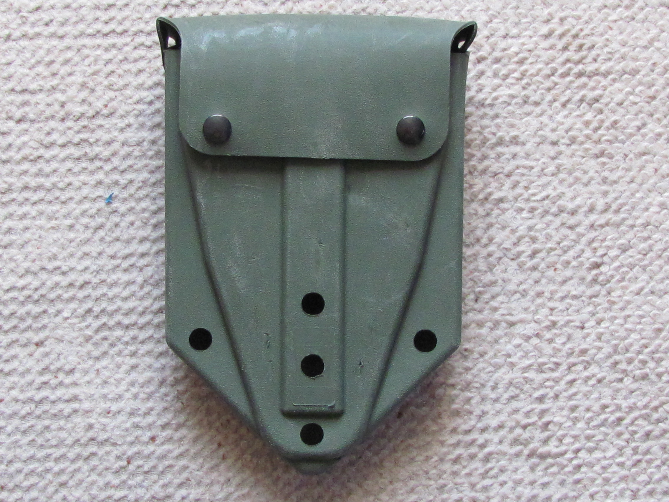 Entrenching tool carrier
